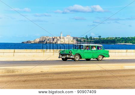 Green classic American car on street of Havana