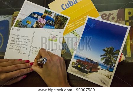 Young woman writes greeting cards from Cuba