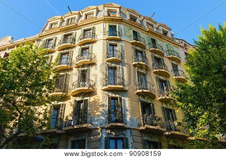 Facade of typical residential building in  Eixample district, Barcelona, Spain