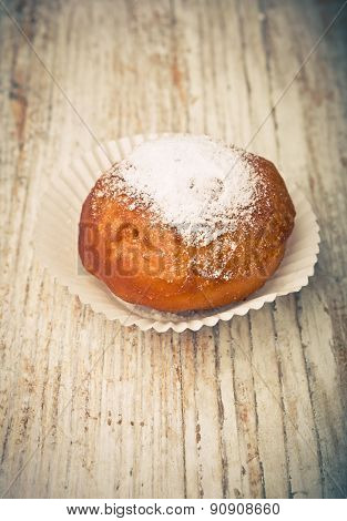 Vintage Photo Of One Homemade Donut On White Table