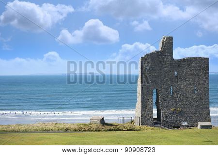 Ballybunion Castle Ruins With Surfers