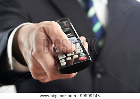 Tv Remote Control In Hand Of Businessman