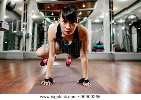 Asian Fitness Girl Stretching In Gym
