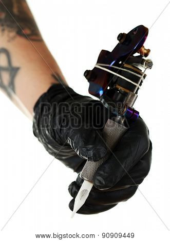 Hand of tattoo artist with tattoo machine isolated on white