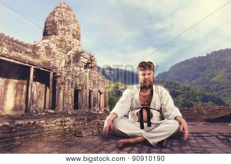 Karate fighter with crossed legs