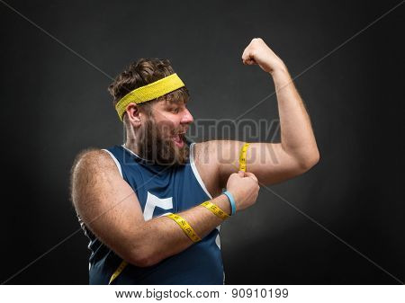 Man measuring his muscle