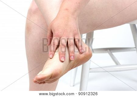 damaged foot problems, neglected. Dermatologist examining a foot for callus and dry skin, towards wh