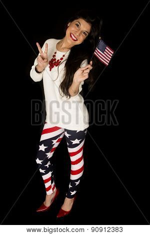 Patriotic Female Holding An American Flag Showing The Peace Sign