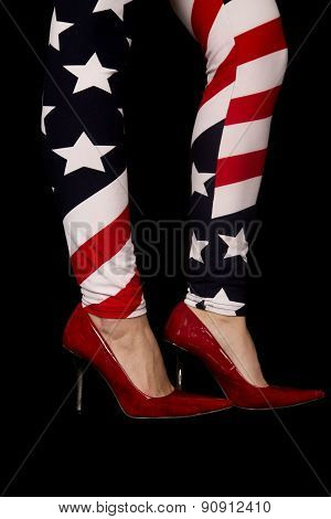 Close Up Of A Woman's Legs Wearing Flag Leggings