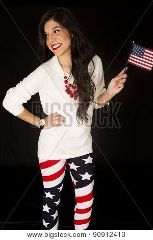 Patriotic Woman With An American Flag And Wearing Flag Leggings