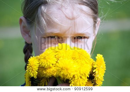 Girl's Face With Yellow Dandelions