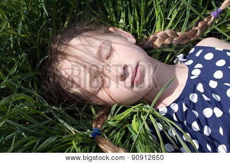 Young Girl Sleeping On Green Grass