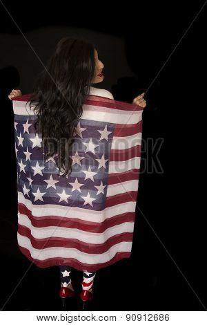 Woman Standing Holding An American Flag Eternal Scarf From Behind