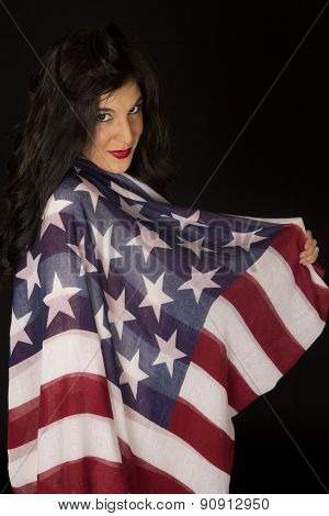 Dark Complected Woman With American Flag Draped Over Her Shoulder
