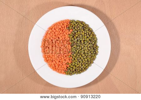Green Mung Beans And Red Raw Lentil On White Plate