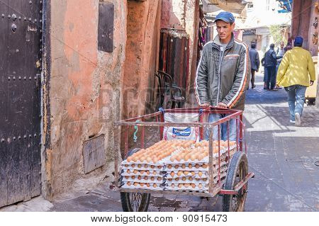 MARRAKESH, MOROCCO, APRIL 16, 2015: Local man pushes a cart with eggs for selling in medina