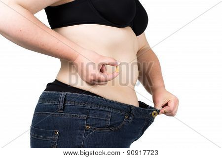 Woman showing her fat body and holding a tablets. Healthy lifestyles concept and diet. Obese neglect