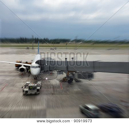 Airplane in airport. Blur motion effect.