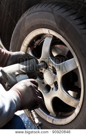 Changing The Wheels In The Automobile Repair Shop