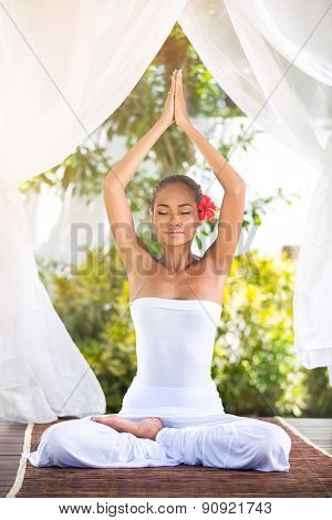 Portrait of healthy young woman doing yoga