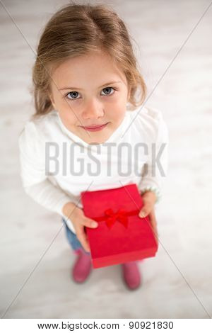 Cute little girl with gift, top view , holidays, presents, birthday concept