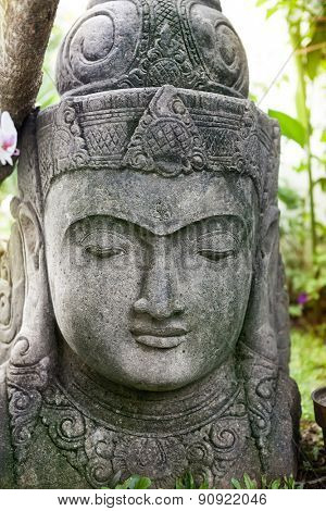 Stone Buddha statue face, close up