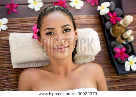 Portrait of beautiful Balinese woman lying on massage desk