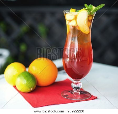 Glass of fresh nonalcoholic cocktail with lime, apple and green mint leaves on wooden table