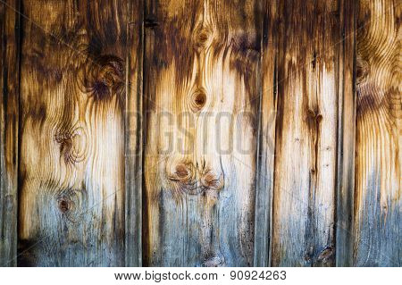 Wooden Wall Made Of Stained Brown Vertical Battens