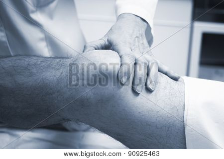 Traumatologist Orthopedic Surgeon Doctor Examining Patient