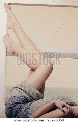 Young Woman Relaxing On Pier Outdoor