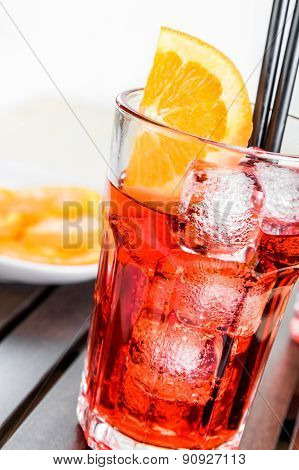 Glasses Of Spritz Aperitif Aperol Cocktail With Orange Slices And Ice Cubes Near Plate Of Slices Ora