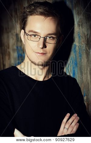 Close-up portrait of a handsome young man in spectacles. Men's beauty, fashion. Business.