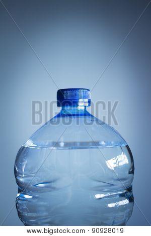 Isolated Plastic Water Bottle Plain Blue Background Studio Shot Close-up