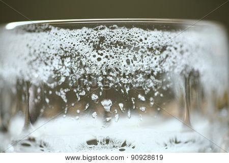 Empty Pint Glass Of Lager Beer Foam Head Closeup Macro