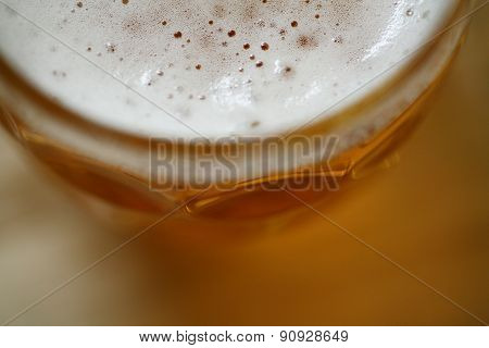 Pint Glass Of Lager Beer With Foam Head Closeup Macro