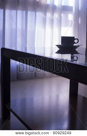 Tea Or Coffee Cup And Saucer On Table Silhouette