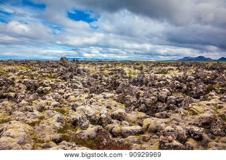 Lava fields in central part of the island. Cloud Iceland in the summer