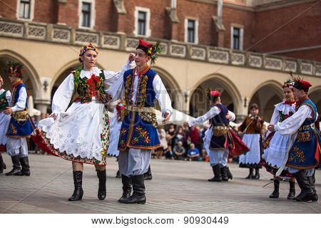 KRAKOW, POLAND - MAY 3, 2015: Polish folk collective on Main square during annual Polish national and public holiday the Constitution Day - May 3, 1791 was adopted first Constitution of modern Europe.