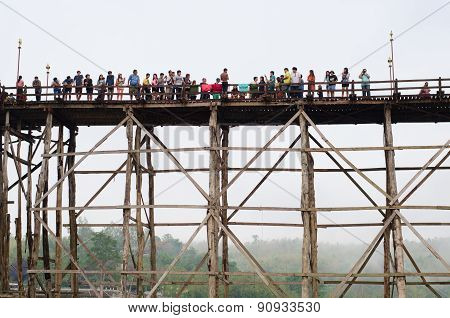 Traveler Crossing Wooden Bridge Or Mon Bridge In Sangklaburi.