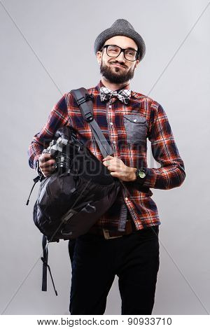 Charismatic photographer journalist in glasses and plaid shirt