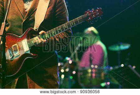 Guitarist silhouette - retro style photo