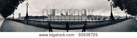 Westminster panorama with chair at waterfront in London..
