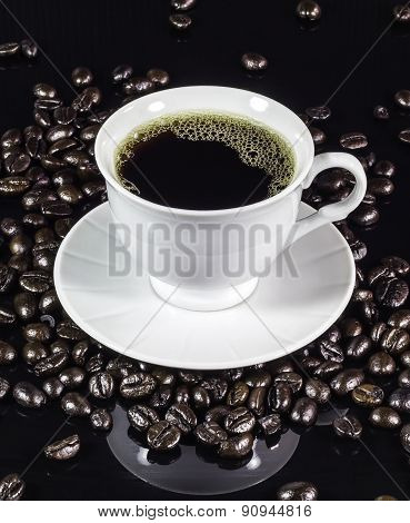 Coffee Cup With Roasted Beans On Black