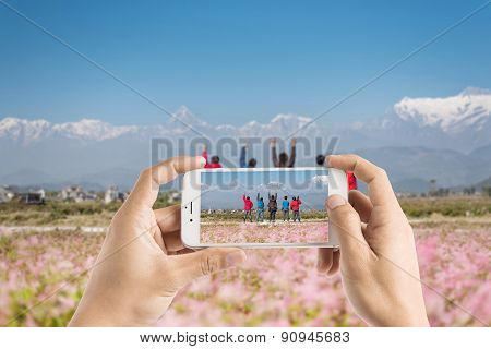 Taking Photo Of Hiker Cheering Elated And Blissful With Arms Raised In The Sky