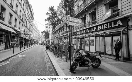 PARIS - SEP 06: streets of Paris on September 06, 2014 in Paris, France. Paris, aka City of Love, is a popular travel destination and a major city in Europe