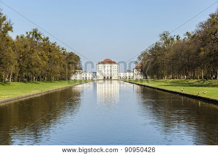 Nymphenburg Castle Grounds In Munich With Reflection In Lake, Germany