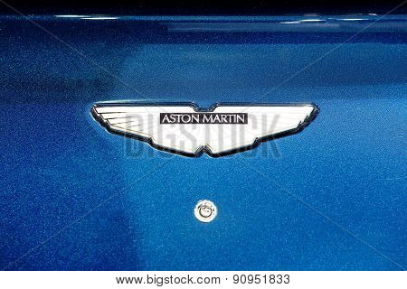 Logo Of Aston Martin On Blue Bonnet