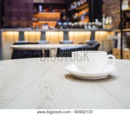 Coffee Cup in Coffee Shop Cafe With Blurred Counter Bar Background