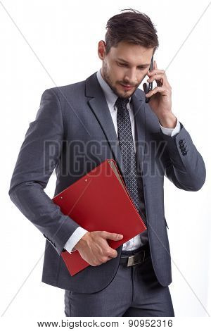 busy businessman with phone and folders